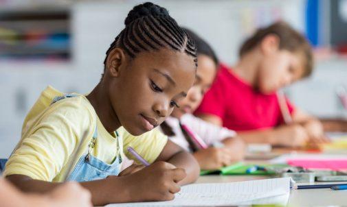 school-girl-writing-in-class